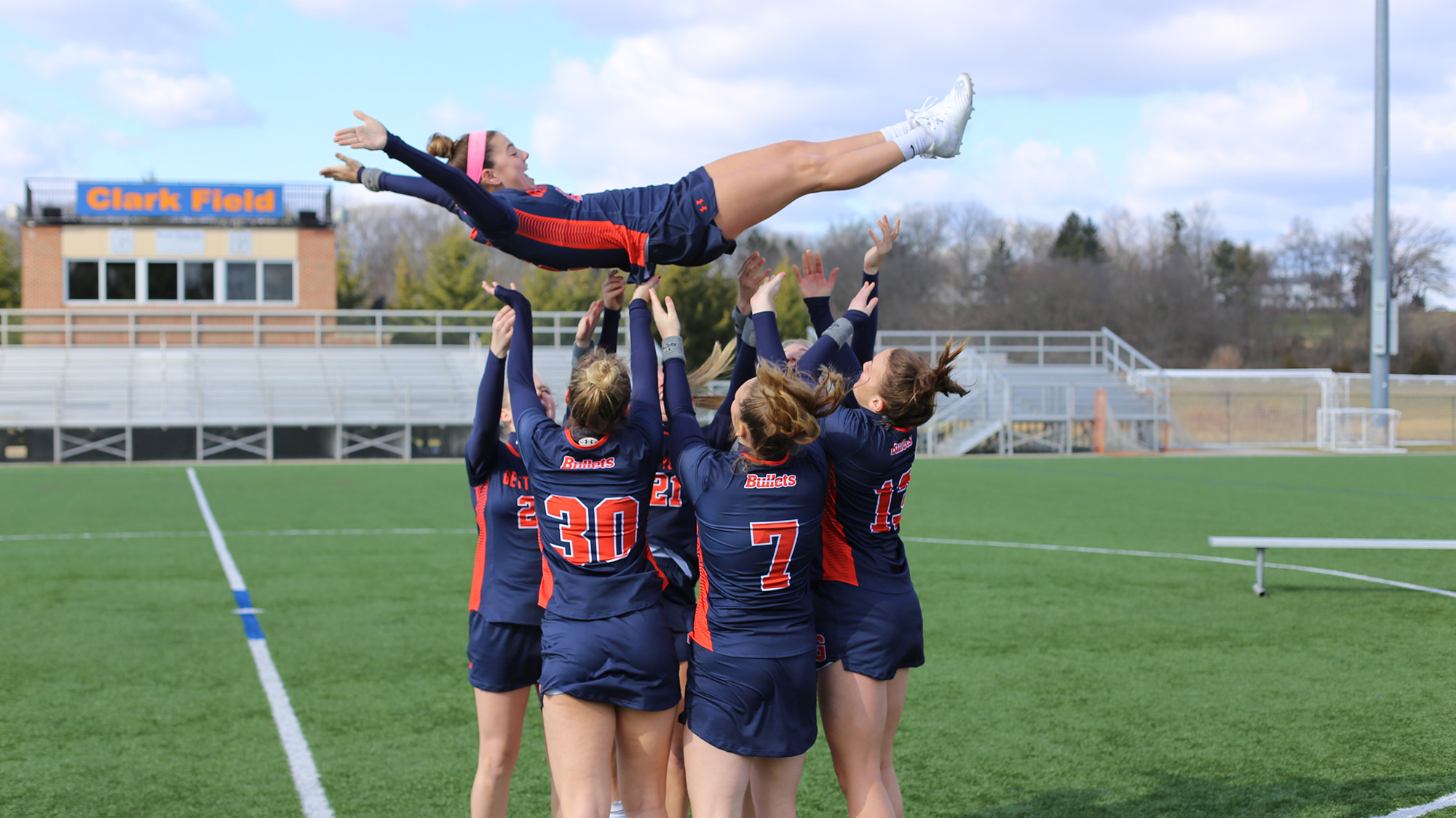 The junior class throws fellow classmate Gabby Dunning in the air.